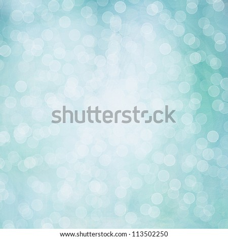 Background of light blue colors. Beautiful shiny Christmas lights, glowing magic bokeh.