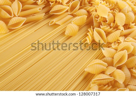 Background of long spaghetti noodles and scattered seashells