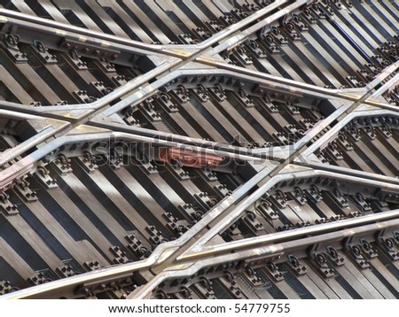 background of lots of rails crossing seen from above