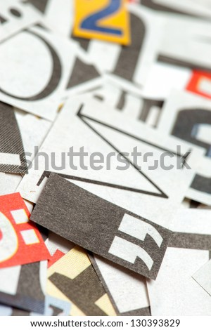 Background of many different letters, cut out from news papers and magazines. Deliberate shallow focus in the center.