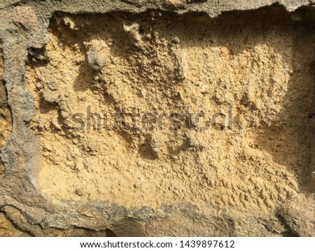 Background of medium brown yellow fine textured sand with both light and shadows showing depth. #1439897612