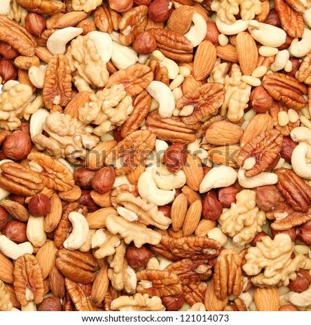 background of mixed nuts - pecans, hazelnuts, walnuts, cashews, almonds, pine nuts, pistachios