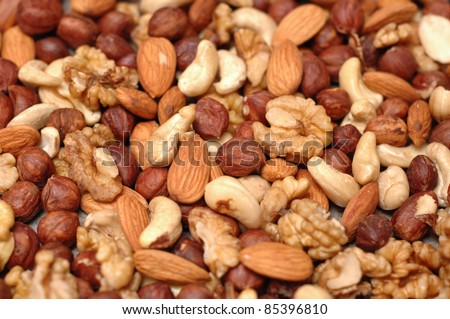 Background of mixed nuts - pecans, hazelnuts, walnuts, cashews, almonds, pine nuts, pistachios,