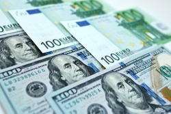 Background of money dollars and euros in a pattern, close up of 100 banknotes of leading currency. Usd and euro paper cash