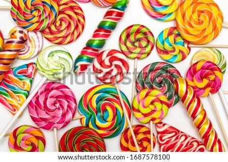 Background of multi-colored caramel on sticks White background Stock foto ©