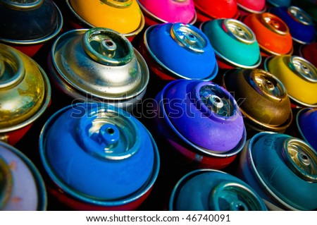 background of multi-colored containers for paint