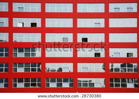 Background of multi glass windows on red building