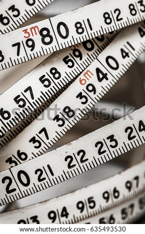 Background of numbers. from zero to nine. Background with numbers. Numbers texture. measuring tape. meter belt #635493530