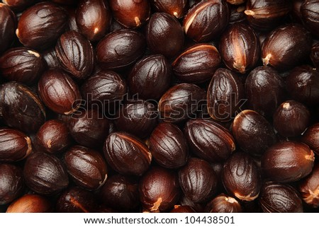 Background of nutmeg seeds with mace removed