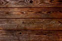 Background of old boards in high contrast. Wallpaper wooden old dark background
