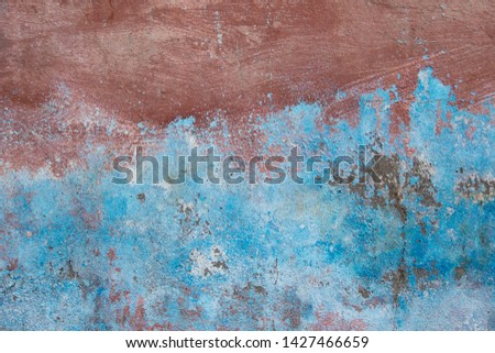 Background of old brick walls with blue-red stucco plaster surfaces Vintage wall wallpaper Rough banner surface with scratches and decay #1427466659
