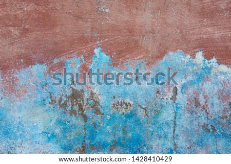 Background of old brick walls with blue-red stucco plaster surfaces Vintage wall wallpaper Rough banner surface with scratches and decay #1428410429
