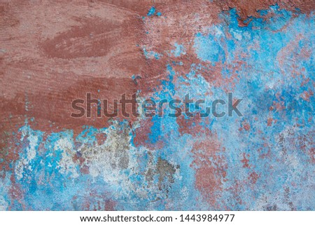 Background of old brick walls with blue-red stucco plaster surfaces Vintage wall wallpaper Rough banner surface with scratches and decay