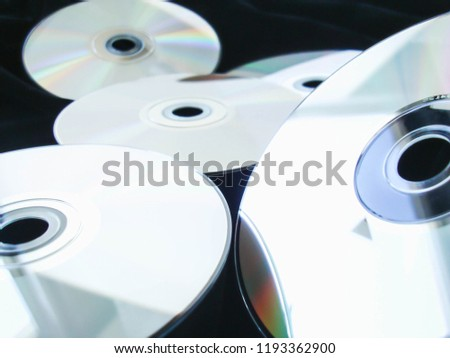 Background of old cd compact disc with soft light and vintage look #1193362900
