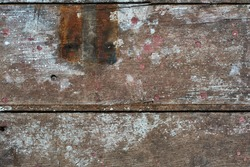Background of old cracked wood panels. Vintage, grunge texture with rusty nails, paint stains and hinge marks.
