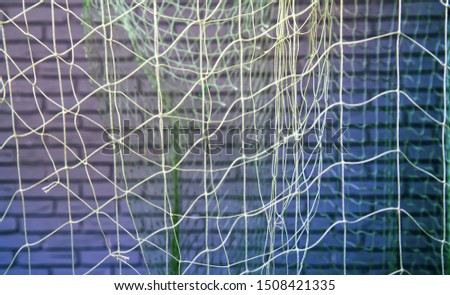 background of old fishing nets hung to dry