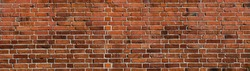 background of old red brick wall. Texture of grunge brickwork