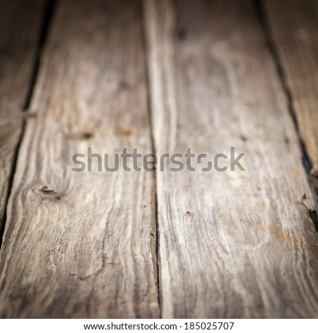 Background of old weathered wooden boards with a diminishing perspective and shallow dof in square format