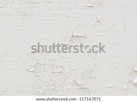 background of old white peeled paint remain on plywood wall.