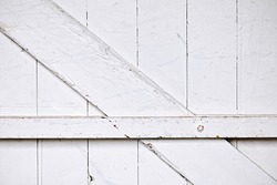 Background of old wooden barn door painted white