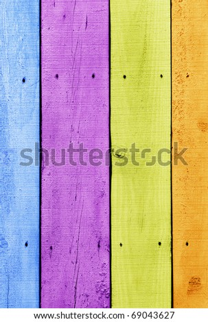 Background of old wooden planks painted with vivid colors
