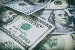 Background of one hundred dollar bills