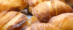 background of pastries called SFOGLIATELLA the typical dessert of the Italian Campania region and of the city of Naples