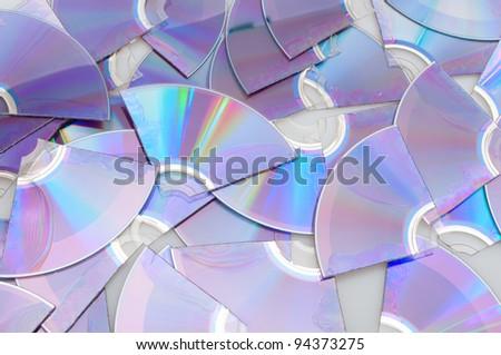 Background of Pieces of Broken CD Compact Discs - stock photo