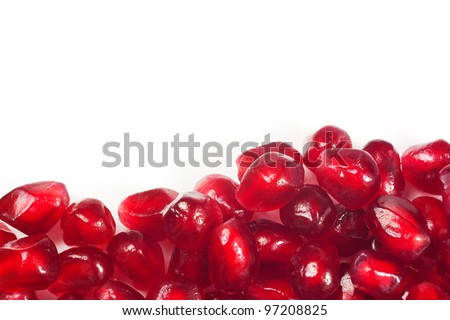 Background of pomegranate seeds isolated on white