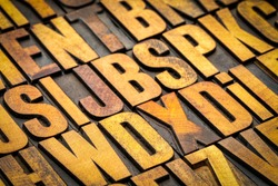background of random vintage letterpress wood type printing blocks stained by color inks