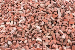 Background of randomly lying red bricks