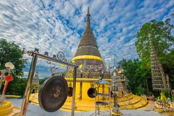Background of religious sights on high mountains in Hat Yai District of Thailand (Phra Maha Ruesee Chedi Tripob Trimongkol) is a beautiful stainless steel pagoda, tourists always come to make merit du