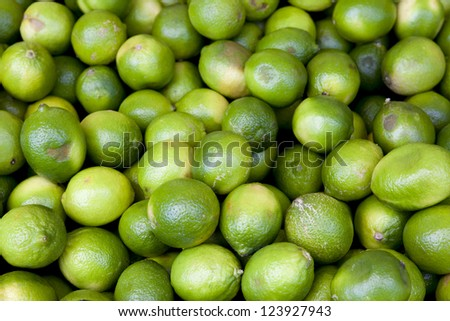 Background of ripe limes for sale.