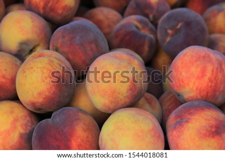 Background of ripe peaches on the market #1544018081