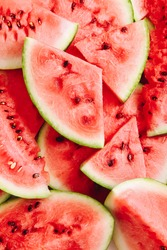 Background of ripe watermelon slices. Top view. Close up