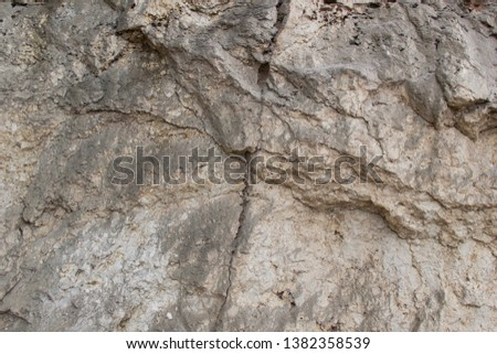 Background of rough granite stone wall #1382358539