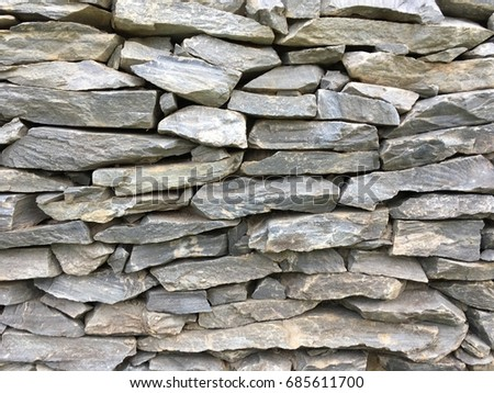background of rough stone wall #685611700