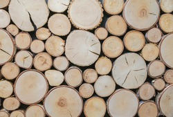 background of round wooden logs