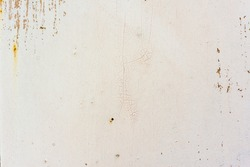 Background of rusty metal wall covered with paint peeling off