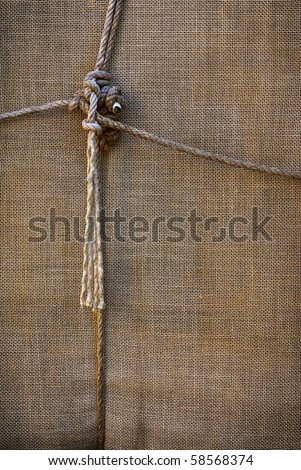background of sackcloth wrap tied up with ropes