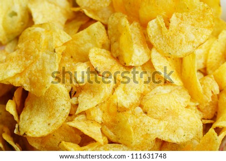 Background of salty potato chips