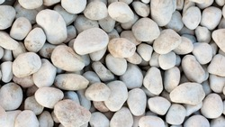 Background of Seashore Grey Rounded Pebble closeup Outdoors
