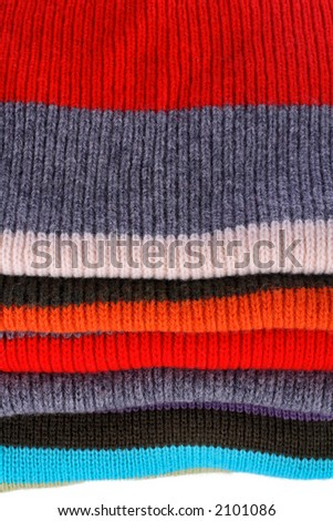 Background of several colors pullovers stack