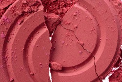 Background of smashed pink blush cosmetic powder