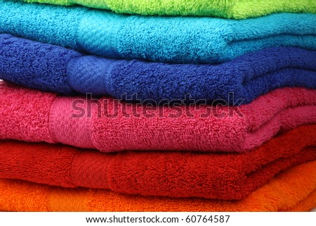 background of stacked colorful fluffy cotton  towels