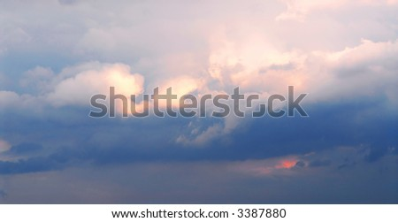 Background of stormy cloudy sky with sunlight shining through