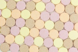 background of sweet sugar candy tablets with popping candy