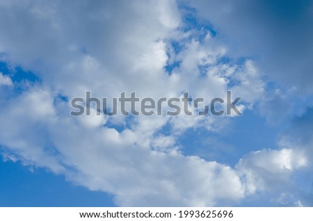 Background of the blue sky with fluffy majestic clouds. Beautiful idyllic landscape. Natural backgrounds.