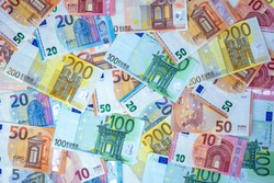 BACKGROUND OF THE EURO BANKNOTES. CONCEPT OF ECONOMY, BANKS, MONEY, WEALTH, FINANCE AND BUSINESS SUCCESS. TOP VIEW.
