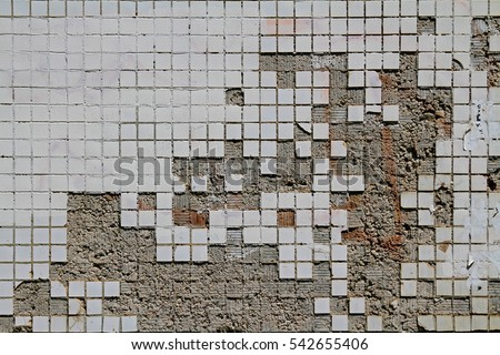 Background of the old and damaged small square tiles